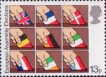 Direct Elections to European Assembly 13p Stamp (1979) Placing flags of member nations into ballot boxes