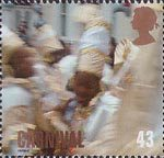 Carnival 43p Stamp (1998) Group of Children in White and Gold Robes